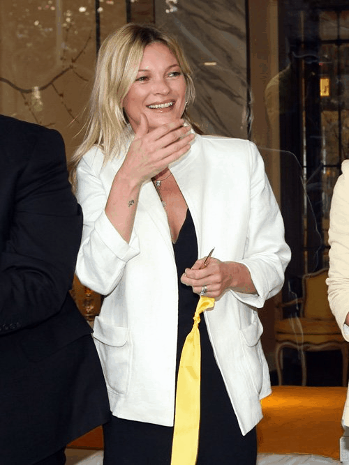 Kate Moss wearing a Lotus jacket